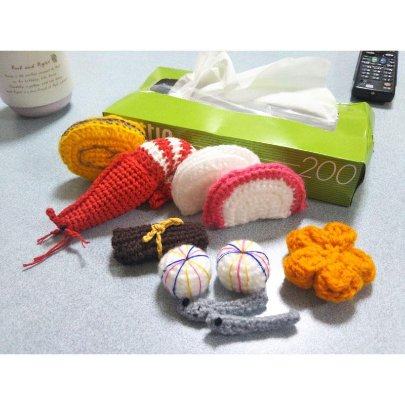 かぎ針編み みぃ。さんの「おせち料理(かまぼこ、伊達巻き、手まり麩)」